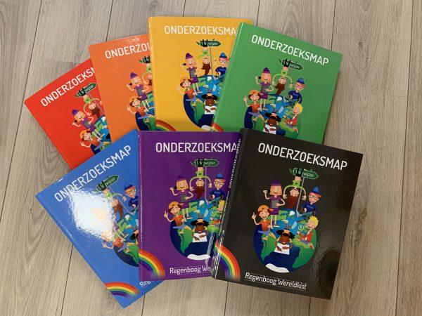 Gekleurde onderzoeksmappen Regenboog Wereldkist